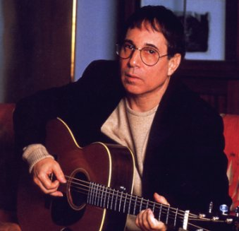 In this version Paul Simon has glasses.